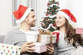 Couple giving christmas presents — Stock Photo