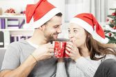 Young christmas couple enjoy time together — Stock Photo