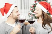 Young couple enjoy chistmas with wine — Stock Photo