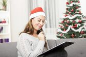Young woman think about christmas wih list — Foto Stock