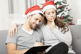 Couple think about to do list for christmas — Stock Photo