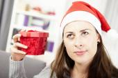 Young girl want to guess christmas gift — Stockfoto