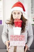 Young girl has a lot of christmas gifts — Stockfoto
