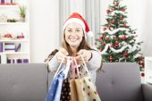 Young girl is give somebody presents bags — Stock Photo