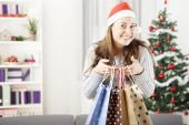 Young girl got some present bags at christmas — Stock Photo