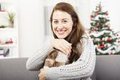 Young girl loves her christmas gift — Stock Photo