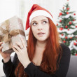 Girl is shaking happy christmas present — Stockfoto #55862177