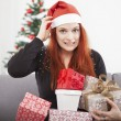 Smiling girl confused head and holding gifts  — Stock Photo #55862215