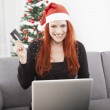 Girl pay with credit card for christmas — Stock Photo #55862241