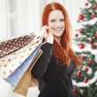 Young happy girl with christmas bags — Stock Photo #55862313