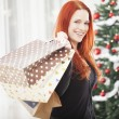Young happy girl with christmas bags — Stock Photo #55862315