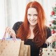 Young happy girl with christmas bags — Stock Photo #55862317
