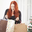 Young happy girl with christmas bags — Stock Photo #55862319