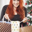 Young happy girl with christmas bags — Stock Photo #55862321