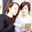 Two young girls with smart phone — Stock Photo #65250163