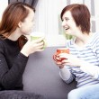 Two happy female friends with coffee cups — Stock Photo #65250173