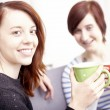 Two happy female friends with coffee cups — Stock Photo #65250233