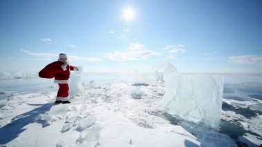 Santa Clauses on frozen lake — Stock Video
