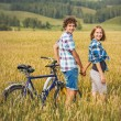 Girl and boy with bicycle — Stock Photo #58293699