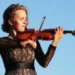 Beautiful young woman playing violin — Stock Video #61243153
