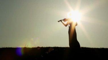 Beautiful young woman playing violin — Stock Video