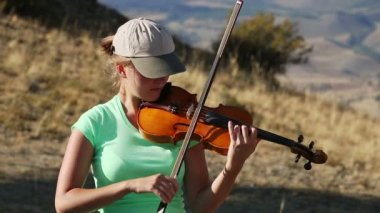 Young Woman playing the violin — Stock Video