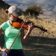 Young Woman playing the violin — Stock Video #68690303