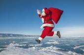 Santa Claus running in the winter — Stok fotoğraf