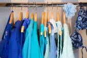 Dressing closet with blue clothes arranged on hangers — Stock Photo