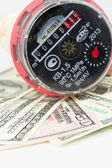 A water meter on a heap of US 100 dollar notes — Stock Photo
