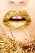 Gold lips — Stock Photo