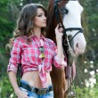 Beautiful woman and her handsome horse on autumn forest — Stock Photo #52502071