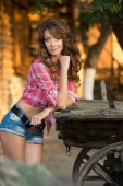 Beautiful woman on ranch near cart.  ranch — Stock Photo