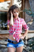 Beautiful woman on ranch near cart.  ranch — Stock Photo