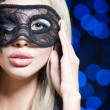 Portrait of Beautiful young woman in black mysterious venetian mask. new year carnival — Stock Photo #61903211