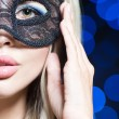 Portrait of Beautiful young woman in black mysterious venetian mask. new year carnival — Stock Photo #61903213