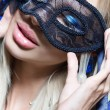 Portrait of Beautiful young woman in black mysterious venetian mask. new year carnival — Stock Photo #61903215