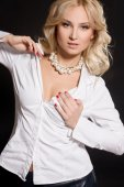 Pretty woman in white shirt and pearl necklace — Stock Photo