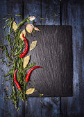 Spices food background with slate on blue wooden table, top view, place for text — Stock Photo