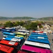 Hills of North Korea afar and lots of tourist buses at the South Korea side — Stock Photo #62717935