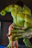 NEW YORK, CIRCA 2011 - Huge Hulk wax figure catches a girl in Madame Tussaud's museum in New York — Stock Photo