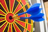 Two darts in bullseye of dartboard — Stock Photo