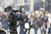Filming an event with a video camera — Stock Photo