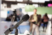 Microphone in focus against blurred background — Stock Photo