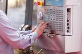 Man working at programmable machine — Stock Photo