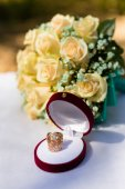 Two wedding rings with a carved pattern in a box — Stock Photo