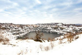 Flooded granite quarry in winter — Stockfoto