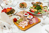 Pickles and cold cuts at the banquet table — Stok fotoğraf