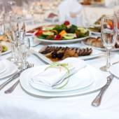 Serviette on a plate on the holiday table served with various di — Stock Photo