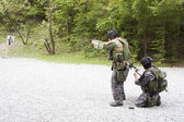 Special police unit in training, school, pistol shooting, outdoor shooting range — Stock Photo